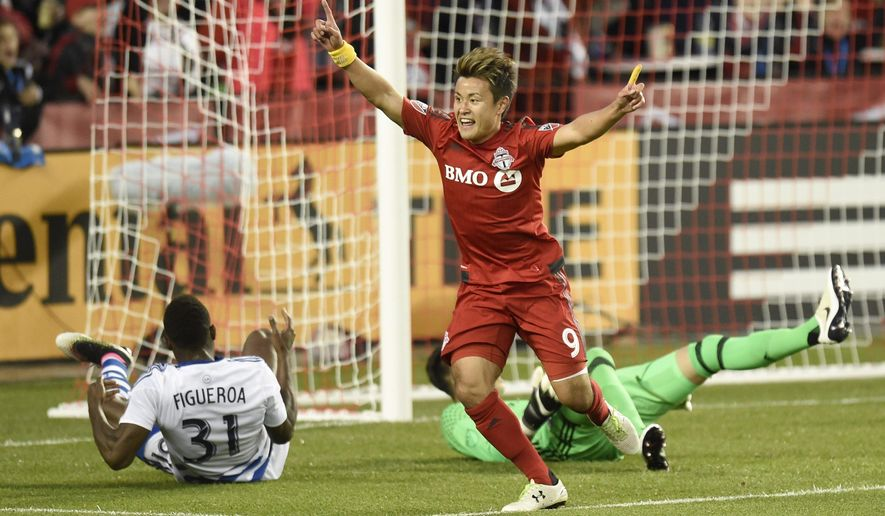 Toronto FC's Tsubasa Endoh (9) celebrates scoring a goal against FC Dallas keeper Chris Seitz during the first half of a MLS soccer match in Toronto on Saturday, May 7, 2016. (Frank Gunn/The Canadian Press via AP) MANDATORY CREDIT