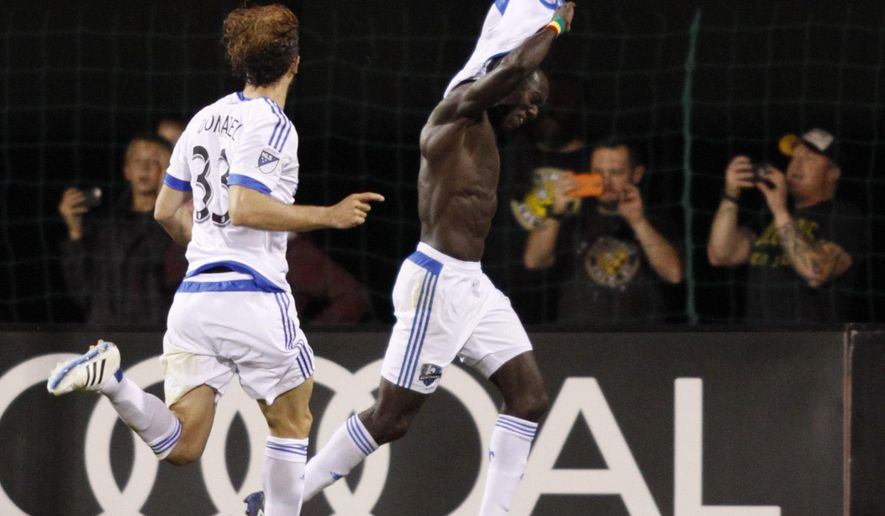 Montreal Impact forward Dominic Oduro, right, of Ghana celebrates with teammate midfielder Marco Donadel, of Italy, after Oduro scored a goal against the Columbus Crew during the second half of a MLS soccer match in Columbus, Ohio, Saturday, May 7, 2016. The match ended in a 4-4 tie. (AP Photo/Paul Vernon)