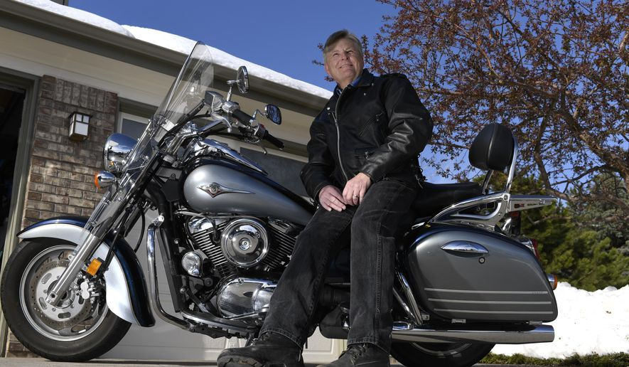 In this April 19, 2016 photo, Wes Cook sits on his motorcycle while wearing the leather jacket that was given to him by Cody Crosby's family, in Parker, Colo. Cook, who was battling liver cancer, received a transplant from Crosby, who died in an auto wreck. Cook is an avid motorcyclist, as was Crosby. Crosby's family gave Cook the motorcycle jacket he used to wear, and now Cook, given a new lease on life, wears it when he rides. (John Leyba/The Denver Post via AP) MAGS OUT; TV OUT; INTERNET OUT; NO SALES; NEW YORK POST OUT; NEW YORK DAILY NEWS OUT; MANDATORY CREDIT