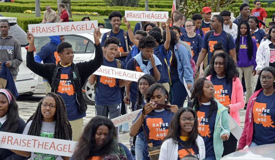 In this April 6, 2016 photo, supporters march in a Raise the Age rally for Juvenile Justice System reform at the Louisiana State Capital, in Baton Rouge, La. Louisiana is one of nine states where 17-year-olds are treated as adults when it comes to the criminal justice system. However, that could change amid a time when jurisdictions across the country are re-evaluating get-tough-on-crime policies.  (Bill Feig /The Advocate via AP)   MAGS OUT; INTERNET OUT; NO SALES; TV OUT; NO FORNS; LOUISIANA BUSINESS INC. OUT (INCLUDING GREATER BATON ROUGE BUSINESS REPORT, 225, 10/12, INREGISTER, LBI CUSTOM); MANDATORY CREDIT