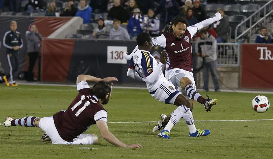 Colorado Rapids midfielder Jermaine Jones, right, takes a shot for a goal as Real Salt Lake defender Demar Phillips, center, defends and Rapids midfielder Shkelzen Gashi looks on in the second half of an MLS soccer game in Commerce City, Colo.,  Saturday, May 7, 2016. The Rapids won 1-0. (AP Photo/David Zalubowski)