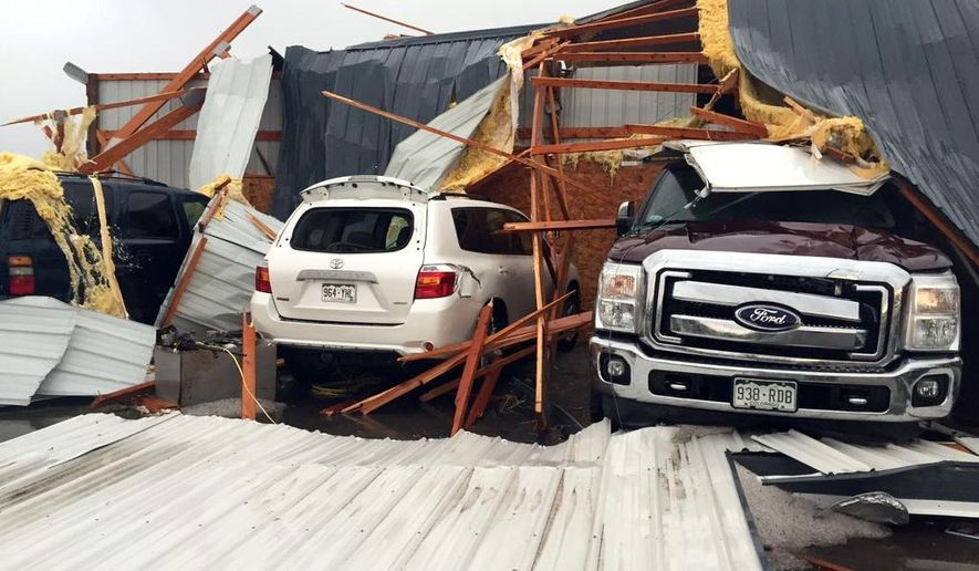 Debris lies on damaged vehicles after a tornado was reported in Weld County outside Wiggins, Colo., Saturday, May 7, 2016. Spring storms menaced parts of the West on Saturday, bringing hail and a tornado sighting in Colorado and deadly driving conditions in Arizona. (Kristen Skovira/KMGH-Channel 7 via AP) MANDATORY CREDIT
