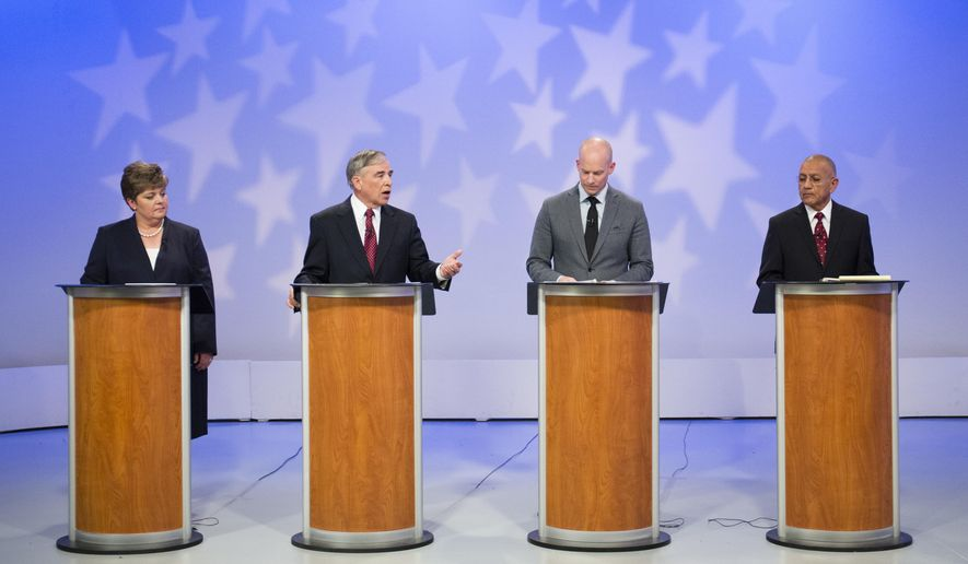 Idaho Supreme Court candidates Attorney Robyn Brody, Idaho Deputy Attorney General Clive Strong, Idaho Sen. Curt McKenzie, R-Boise, and Idaho Court of Appeals Judge Sergio Gutierrez debate at the studios of Idaho Public Television in Boise, Idaho, on Friday, May 6, 2016. (AP Photo/Otto Kitsinger)