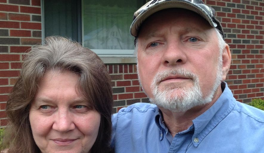 Morris Bounds Sr. and his wife, Patricia Bounds, are shown Wednesday, April 27, 2016, at their new home in Falls View, W.Va.  Morris Bounds was in his other home across the Kanawha River near Mount Carbon on Feb. 16, 2015, when 27 cars of a CSX oil train derailed nearby and exploded. Bounds suffered only inhalation injuries.  (AP Photo/John Raby)