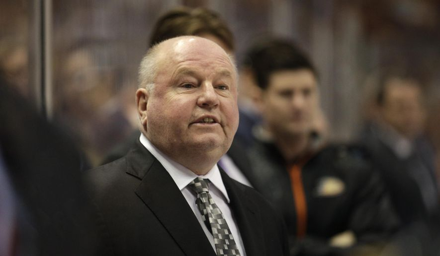 FILE - In this Wednesday, April 8, 2015 file photo, Anaheim Ducks head coach Bruce Boudreau coaches his team during the first period of an NHL hockey game against the Dallas Stars in Anaheim, Calif. Bruce Boudreau has agreed to terms to coach the Minnesota Wild. Wild general manager Chuck Fletcher announced the move Saturday night, May 7, 2016. Boudreau was fired by Anaheim two days after the four-time Pacific Division champions' first-round exit from the playoffs. He was 208-104-40 in parts of five seasons with the Ducks after going 201-88-40 in parts of five seasons with the Washington Capitals. (AP Photo/Jae C. Hong, File)