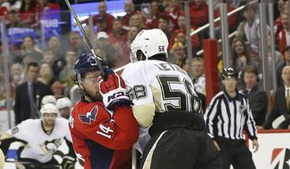 iceWashington Capitals right wing Justin Williams (14) collides with Pittsburgh Penguins defenseman Kris Letang (58) during the second period of Game 5 in an NHL hockey Stanley Cup Eastern Conference semifinals Saturday, May 7, 2016 in Washington. (AP Photo/Pablo Martinez Monsivais)