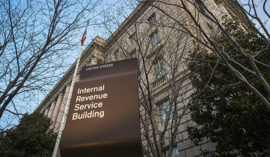 This April 13, 2014, file photo shows the Internal Revenue Service (IRS) headquarters building in Washington. Millions of taxpayers face a midnight deadline Monday, March 18, 2016, to file their tax returns, while millions of other Americans seek more time, a six-month extension. The filing deadline was delayed three days beyond the traditional April 15 deadline, because Friday was a legal holiday in the District of Columbia.  (AP Photo/J. David Ake, File) — FILE