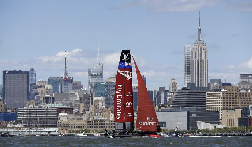 Emirates Team New Zealand sails past the Empire State Building, tallest at right, during an America's Cup World Series sailing event in New York, Sunday, May 8, 2016. Emirates Team New Zealand won the N.Y. event. (AP Photo/Seth Wenig)