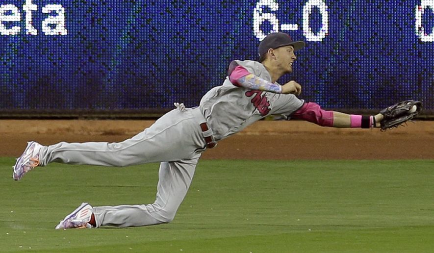 Philadelphia Phillies left fielder Tyler Goeddel (2) catches a line drive by Miami Marlins' Martin Prado in the first inning of a baseball game, Sunday, May 8, 2016, in Miami. (AP Photo/Alan Diaz)
