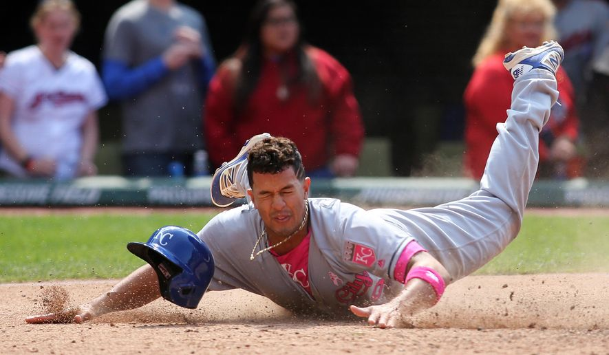 Kansas City Royals' Cheslor Cuthbert slides after being tagged out at home plate by Cleveland Indian catcher Yan Gomes in the seventh inning during a baseball game Sunday, May 8, 2016, in Cleveland. (AP Photo/Aaron Josefczyk)