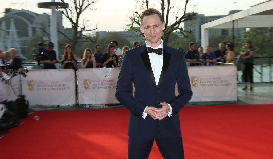 Actor Tom Hiddleston poses for photographers upon arrival at the British Academy Television Awards' in London, Sunday, May 8, 2016. (Photo by Joel Ryan/Invision/AP)