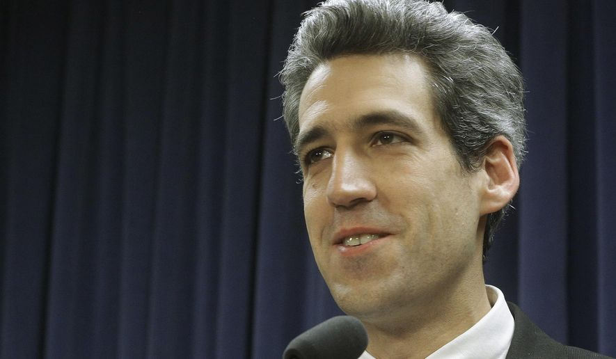 In this Jan. 13, 2016 photo, Illinois Sen. Daniel Biss, D-Skokie, speaks to reporters during a news conference at the Illinois State Capitol in Springfield, Ill. Powerful devices used by law enforcement to mimic cell towers and track phone locations is raising privacy concerns and inspiring legislation nationally to set restrictions for how police can use the technology in criminal investigations. (AP Photo/Seth Perlman)