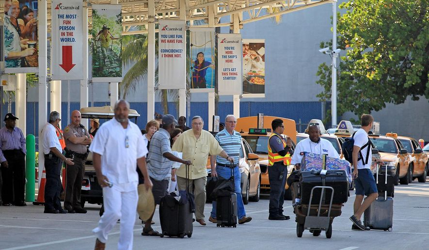 Passengers from cruise ship Adonia exit the terminal after arriving at the Port of Miami from the historic trip to Cuba, Sunday, May 8, 2016. It was the first regular cruise to travel directly from the United States to Cuba in more than half a century. (Carl Juste/The Miami Herald via AP)  MAGS OUT; MANDATORY CREDIT