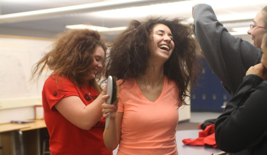 ADVANCE FOR THE WEEKEND OF MAY 7-8 AND THEREAFTER - Nirvana Mendoza, center, has her hair ratted by Kinzey Cooper, left, and Kelany Stalker in preparation for a dress rehearsal of An Evening of One-Acts at North Platte High School on Monday, May 2, 2016.  Students directed and acted in an evening of one-acts at North Platte High School this past week. The production consisted of three one-act plays helmed completely by students.  (Kamie Stephen/The Telegraph via AP) MANDATORY CREDIT