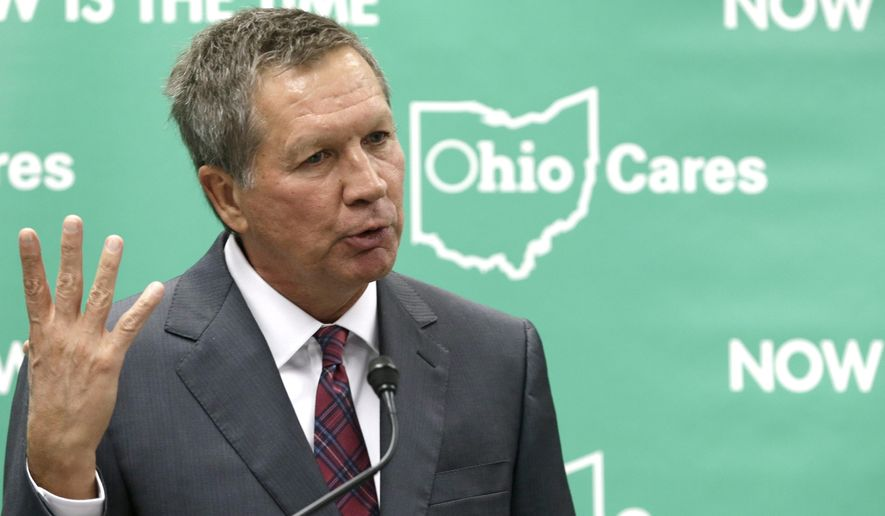 ADVANCE FOR SUNDAY, MAY 8 - FILE - In this Oct. 18, 2013, file photo, Ohio Gov. John Kasich makes a push to expand eligibility for Medicaid health coverage for low-income residents, while speaking at the Cleveland Clinic in Cleveland. The Republican governor's administration is preparing to seek federal approval for provisions of a Healthy Ohio program that would introduce monthly charges for Medicaid coverage in 2018, and is currently gathering public feedback as part of plans to submit a proposed waiver in June 2016. (AP Photo/Tony Dejak, File)