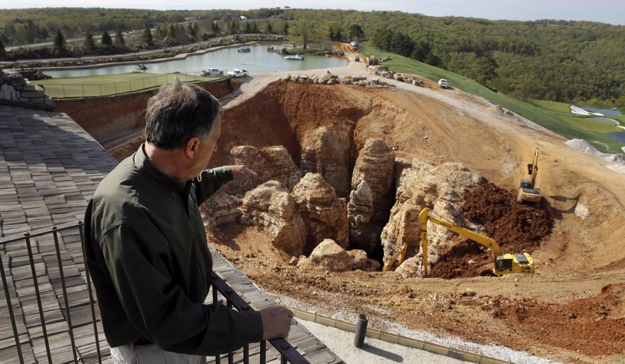 Sinkhole spurs search for cave by Bass Pro Shops founder