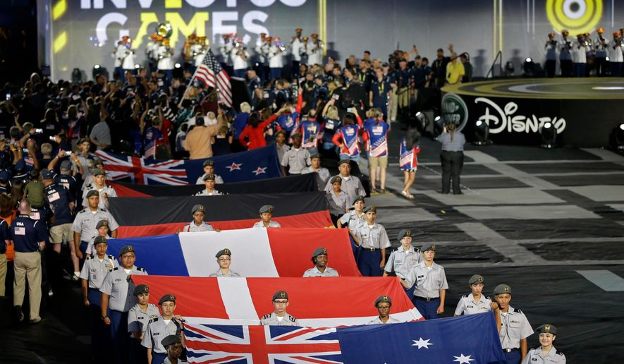 Flags of some of the participating nations are displayed during the opening ceremony for the Invictus Games, Sunday, May 8, 2016, in Kissimmee, Fla. A total of 14 nations will participate in the games. (AP Photo/John Raoux)