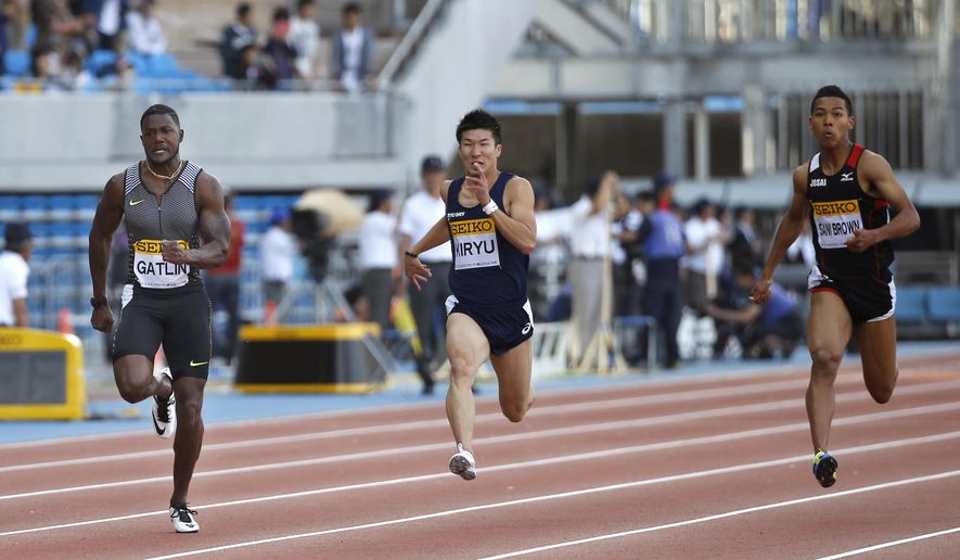 Justin Gatlin, left, of the United States competes ahead of Yoshihide Kiryu, center, and Abdul Hakim Sani Brown of Japan at the men's 100 meter of the Golden Grand Prix track and field in Kawasaki, near Tokyo, Sunday, May 8, 2016. (AP Photo/Shizuo Kambayashi)