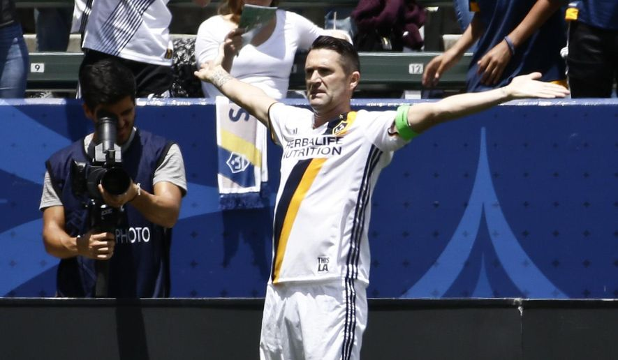 Los Angeles Galaxy forward Robbie Keane celebrates scoring against the New England Revolution during the first half of an MLS soccer game on Sunday, May 8, 2016 in Carson, Calif. (AP Photo/Chris Carlson)