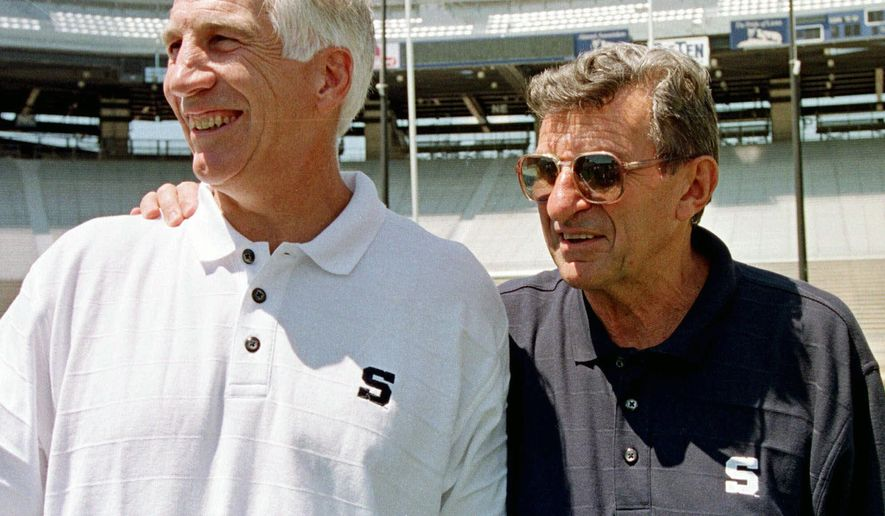 FILE - In this Aug. 6, 1999, file photo, Penn State head football coach Joe Paterno, right, poses with his defensive coordinator Jerry Sandusky during Penn State Media Day at State College, Pa. Penn State President Eric Barron is decrying new allegations in a letter Sunday, May 8, 2016, that former coach Paterno was told that Sandusky had sexually abused a child as early as 1976 and that assistant coaches witnessed the abuse of other children. (AP Photo/Paul Vathis, File)