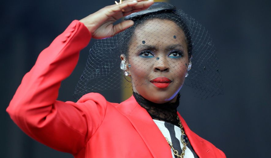 """FILE - In this April 29, 2016 file photo, Lauryn Hill and her band perform at Congo Square during the New Orleans Jazz and Heritage Festival at the Fair Grounds in New Orleans. Hill says that she will """"make it up"""" to her fans after she enraged those in attendance at an Atlanta concert Friday, May 6, 2016, by arriving two hours late and performing for fewer than 40 minutes. (David Grunfeld/NOLA.com The Times-Picayune via AP), File MAGS OUT; NO SALES; USA TODAY OUT; THE BATON ROUGE ADVOCATE OUT; THE NEW ORLEANS ADVOCATE OUT; MANDATORY CREDIT /NOLA.com The Times-Picayune via AP) MAGS OUT; NO SALES; USA TODAY OUT; THE BATON ROUGE ADVOCATE OUT; THE NEW ORLEANS ADVOCATE OUT; MANDATORY CREDIT"""