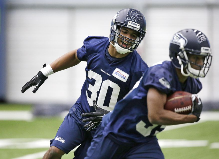 Seattle Seahawks' Zac Brooks (30) gives chase during an NFL football rookie minicamp workout Sunday, May 8, 2016, in Renton, Wash. (AP Photo/Elaine Thompson)