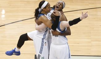 FILE - In a Wednesday, Oct. 14, 2015 file photo, Minnesota Lynx's Lindsay Whalen, Maya Moore and Rebekkah Brunson celebrate their 69-52 victory over the Indiana Fever in Game 5 of the WNBA basketball finals, in Minneapolis. The Minnesota Lynx have won three championships in the last five years and come as close to a dynasty as the WNBA has seen in the last 15 years. The one thing the Lynx have yet to do is repeat as champions.  (AP Photo/Stacy Bengs, File)
