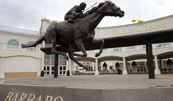 The statue of Kentucky Derby winner Barbaro sits outside the main entrance of Churchill Downs, Wednesday, April 10, 2013, in Louisville, Ky. With a Sugar Bowl football win and a men's college basketball national championship within the past six months, and the Kentucky Derby horse race less than a month away, it's a great time to be a sports fan in Kentucky. (AP Photo/Timothy D. Easley)