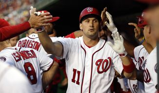 Washington Nationals first baseman Ryan Zimmerman (11) celebrates hitting a sacrifice fly to score a run during the first inning of a baseball game against the Atlanta Braves at Nationals Park, Monday, April 11, 2016, in Washington. (AP Photo/Alex Brandon)