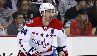 Washington Capitals' Brooks Orpik (44) skates during the second period of an NHL hockey game against the Pittsburgh Penguins in Pittsburgh Saturday, Dec. 27, 2014. The Penguins won 3-0. (AP Photo/Gene J. Puskar)