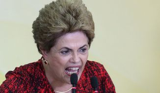 Brazil's President Dilma Rousseff speaks during a ceremony that announced the opening of new federal universities at Planalto presidential palace in Brasilia, Brazil, Monday, May 9, 2016. (AP Photo/Eraldo Peres) ** FILE **