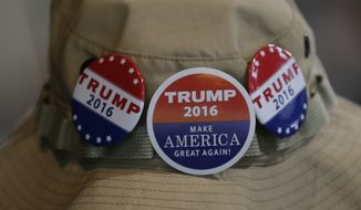 A supporter of Republican presidential candidate Donald Trump wears buttons supporting Trump during a rally in Spokane, Wash., Saturday, May 7, 2016. (AP Photo/Ted S. Warren)