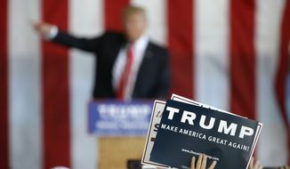 A supporter holds a sign as Republican presidential candidate Donald Trump speaks at a rally in Omaha, Neb., on May 6, 2016. (Associated Press)