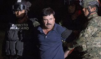 "FILE - In this Jan. 8, 2016 file photo, Mexican drug lord Joaquin ""El Chapo"" Guzman is escorted by soldiers to a waiting helicopter at a federal hangar in Mexico City, after he was recaptured from breaking out of a maximum security prison in Mexico. A Mexican judge said on Monday, May 9, 2016 that Guzman's extradition to the U.S. can move ahead, but the country's foreign ministry must still approve it and the defense can appeal. (AP Photo/Rebecca Blackwell, File)"