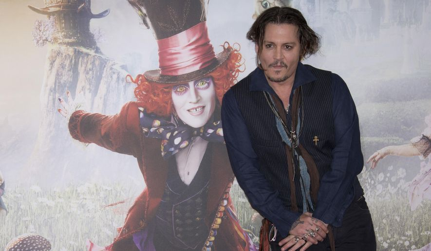 Actor Johnny Depp poses for photographers at the photo call of Alice Through The Looking Glass, at a central London hotel, Sunday, May 8, 2016. (Photo by Joel Ryan/Invision/AP)