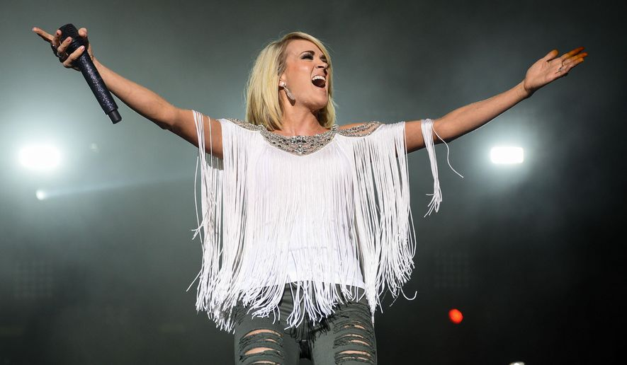 FILE - In this April 1, 2016, file photo, Carrie Underwood performs at the 4th Annual ACM Party for a Cause Festival Day 1 at MGM Resorts festival grounds in Las Vegas. Underwood, Chris Stapleton and Cam are in a three-way tie with nominations for the 2016 CMT Music Awards. CMT announced the nominees on Monday, May 9, 2016, for the awards show to be held live from Nashville, Tenn., on June 8. (Photo by Al Powers/Powers Imagery/Invision/AP, File)