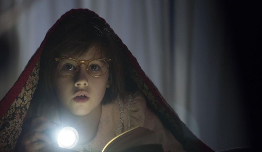 "In this image released by Disney, Ruby Barnhill portrays Sophie in a scene from ""The BFG,"" opening nationwide on July 1. (Doane Gregory/Disney via AP)"