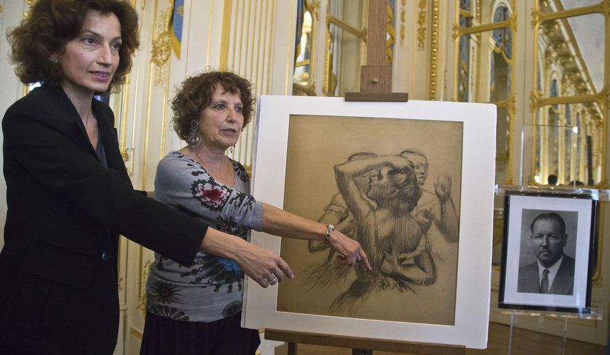 "French Culture Minister Audrey Azoulay, left, and Viviane Dreyfus daughter of the late Maurice Dreyfus pose next to the late 19th century drawing ""Trois danseuses en buste"" by Edgar Degas, as she listens to the speech of French Culture Minister Audrey Azoulay in Paris, France, Monday, May 9, 2016. The French government hands over an Edgar Degas drawing to the family of Maurice Dreyfus 76 years after it was stolen by Nazi occupiers. The photo of the late Maurice Dreyfus, right. (AP Photo/Michel Euler)"