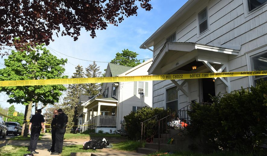 Jackson Police Department officers work at the scene of a homicide in the 400 block of W. High Street on Sunday, May 8, 2016, in Jackson, Mich. Police in Jackson say a woman has been taken into custody following the shooting death of a 27-year-old man. (J. Scott Park/Jackson Citizen Patriot via AP)