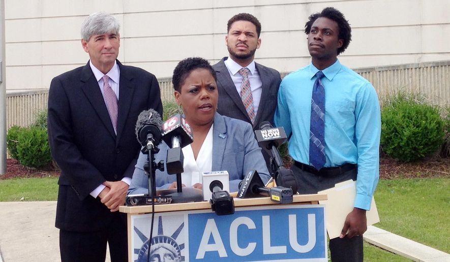 Jennifer Riley-Collins, executive director of the American Civil Liberties Union of Mississippi, center, speaks Monday, May 9, 2016, in Jackson, Miss., about a lawsuit the group filed against the state over House Bill 1523, which will allow workers to cite their own religious objections to same-sex marriage and deny services to citizens. Behind Riley-Collins are attorney Oliver Diaz, left, and plaintiffs in the lawsuit, Nykolas Alford and Stephen Thomas. Alford and Thomas, of Meridian, Miss., are engaged. The lawsuit asks a federal judge to declare that House Bill 1523 violates the equal-protection guarantee of the 14th Amendment and to block the state from enforcing the measure, which is set to become law July 1. (AP Photo/Emily Wagster Pettus)
