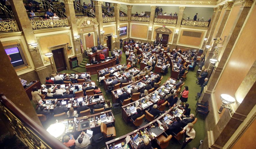 FILE - In this March 10, 2016, file photo, the House of Representatives debate on the floor in Salt Lake City. A first-in-the-country requirement that women receive anesthesia before abortions after 20 weeks of pregnancy is one of about 350 new Utah laws that take effect Tuesday, May 10, 2016. (AP Photo/Rick Bowmer, File)