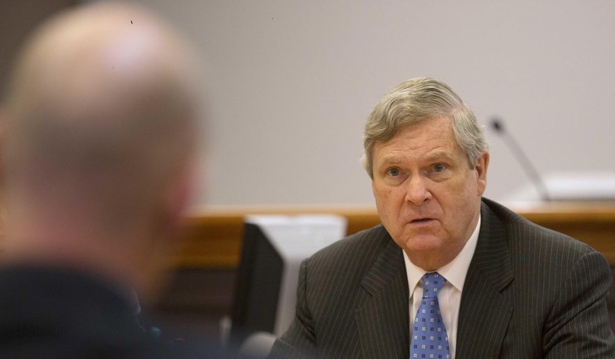 Then-U.S. Secretary of Agriculture Tom Vilsack talks with former heroin addict Chris Overka at a meeting at the Hillsborough County Superior Court, Monday, May 9, 2016, in Nashua, N.H., to hear about its drug court program. (AP Photo/Jim Cole) ** FILE **