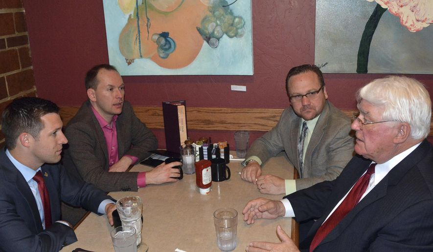 From left, Nebraska state Sen. Adam Morfeld, Open Primaries director of outreach Jason Olson, Nebraska state Sen. Colby Coash and Nebraska Speaker of the Legislature Galen Hadley discuss a South Dakota ballot measure that would make the state's elections nonpartisan, Monday, May 9, 2016, in Sioux Falls, S.D. (AP Photo/Dirk Lammers)