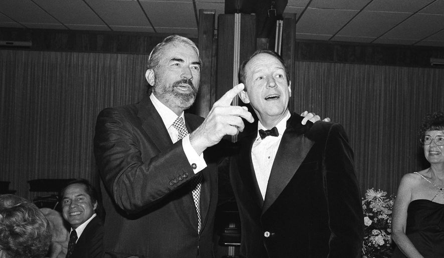 FILE - In an Oct. 14, 1979 file photo, actor Gregory Peck, left, points out someone to actor William Schallert, formerly of the Patty Duke Show, during the Girls Friday of Show Business 1979 Celebrity Benefit  Ball in Los Angeles, Calif. Schallert, who played Patty Duke's father and uncle in her '60s sitcom and led a long, contentious strike for actors, died Sunday, May 8, 2016, at his home in Pacific Palisades, Calif., said his son, Edwin. He was 93.(AP Photo, File)