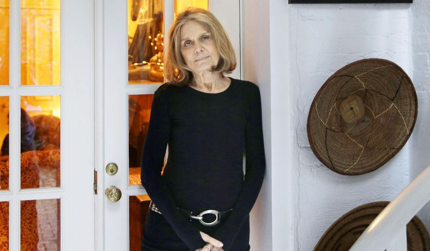 """FILE - In this Oct. 19, 2015, file photo, Gloria Steinem poses for a picture at her home in New York. Steinem will host and produce a new television series on the Viceland network, called """"Woman,"""" about the political impact of violence against women throughout the world. The series premieres on May 10. (AP Photo/Seth Wenig)"""