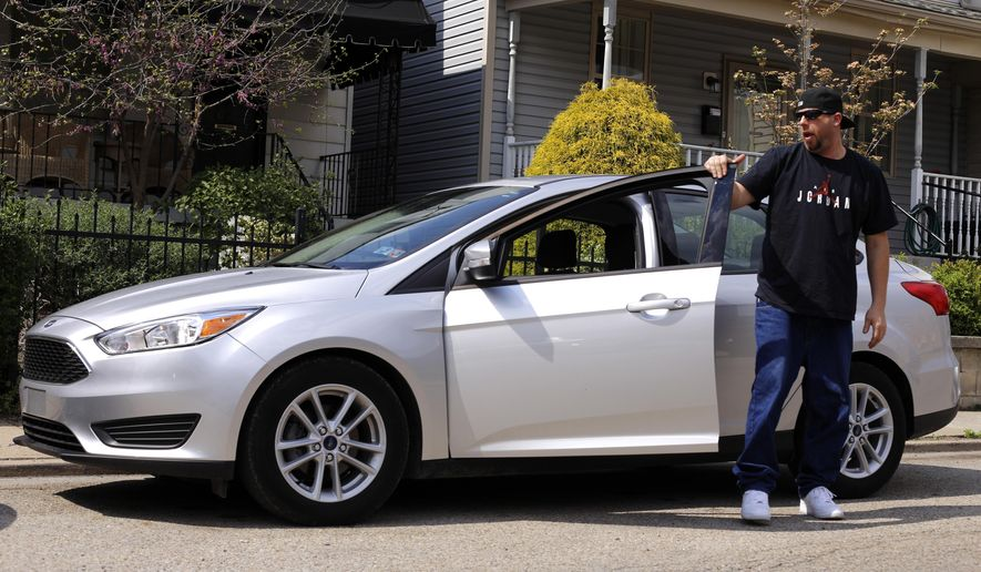In this Tuesday, April 26, 2016, photo, Louis Cervi gets out of his leased Ford Focus after parking near his Pittsburgh home. Cervi had been looking to buy a small car for basic transportation, with a reasonable monthly payment. With many Americans rushing to buy trucks and SUVs, there are good deals to be had on cars, especially smaller models. (AP Photo/Gene J. Puskar)