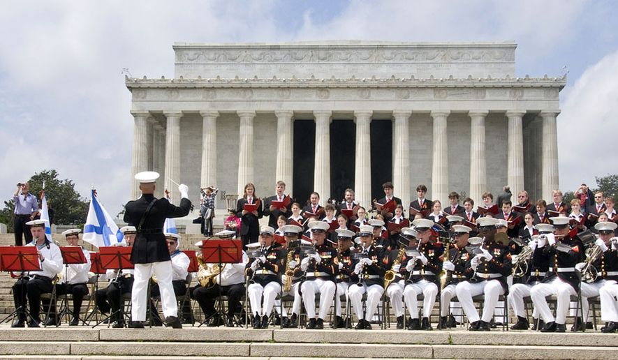 "A joint Russian and American marine band performing at the Lincoln Memorial to celebrate the 65th anniversary of the ""Meeting at the Elbe River"" on April 25, 1945."