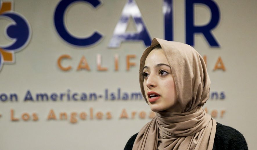 "Bayan Zehlif, 17, speaks during a news conference on Monday, May 9, 2016 in Anaheim, Calif. Zehlif has posted a photo on Facebook of herself in a hijab with the name ""Isis Phillips"" underneath it as it appears in the Los Osos High School yearbook. She writes in the post that she's ""extremely saddened, disgusted, hurt and embarrassed."" She says the school told her it was a ""typo"" but she says, ""I beg to differ."" (AP Photo/Chris Carlson)"
