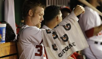 Washington Nationals starting pitcher Stephen Strasburg (37) wraps his arm after pitching against the Los Angeles Dodgers during the second inning of a baseball game against the Los Angeles Dodgers, in his first major league start since undergoing Tommy John surgery, at Nationals Park in Washington, on Tuesday, Sept. 6, 2011. (AP Photo/Jacquelyn Martin)