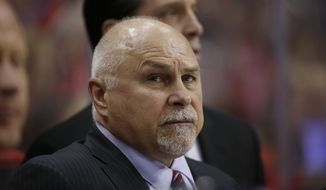Washington Capitals head coach Barry Trotz stands in the bench in the second period of an NHL hockey game against the New York Islanders, Tuesday, April 5, 2016, in Washington. (AP Photo/Alex Brandon)